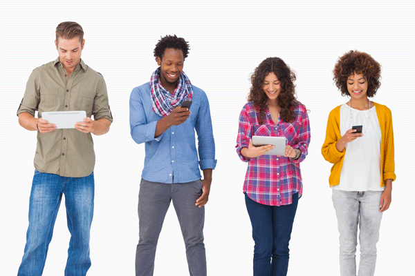 Photograph of people looking at letters and their phones