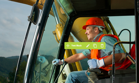 Construction truck driver sitting in the cab manipulating controls